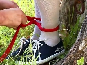 Katarina a college babe is tied to a tree and striped down showin off her big...