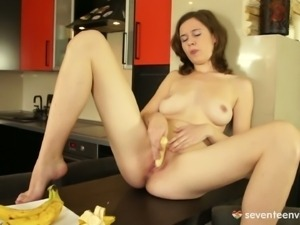 Busty lucie licks banana and rubs i on her pussy
