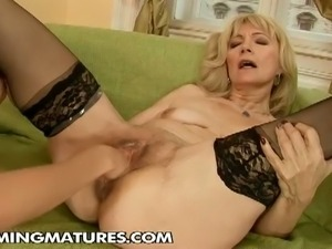 Blonde mature gets fisted and dildoed with a bat
