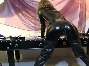 Sexy babe poses in her vinyl suit