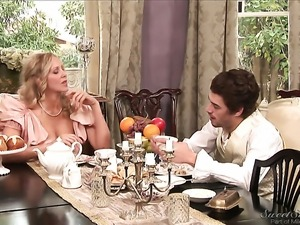 Julia Ann blows Xander Corvuss cock with passion