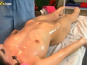 Pretty young chic Nene is lying on the couch at massage saloon and getting...