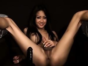Shemale riding huge black dildo