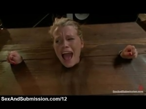 Blonde immobilized in the wall stockade and whipped and vibed free