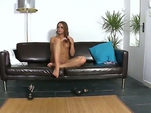 Sensual and arousing tanned brunette babe Irina Bruni enjoys in showing her...