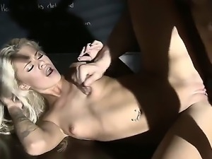 Jessa Rhodes gets laid down over a table and fucked like crazy by a hunk....