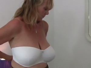 Horny grandma tries on clothes and masturbates
