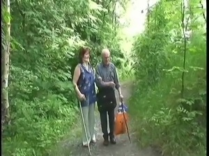 redheaded granny sucks off grandad in the woods