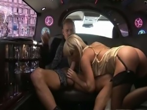 Horny blonde takes a fat cock in the back of a posh car