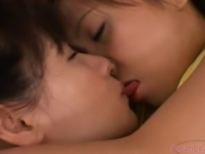 Lesbians asia girls suck nipples on bed.