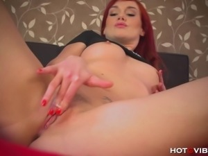 Sexy, redheaded Czech babe plays with her HotGVibe, fingering her pretty,...