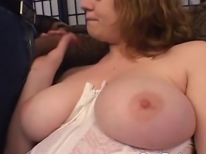 Busty MILF sucks a massive black cock before she takes it in her hairy pussy