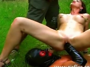 Hot brunette babe gets a brutally deep fisting and covered in piss in a forest