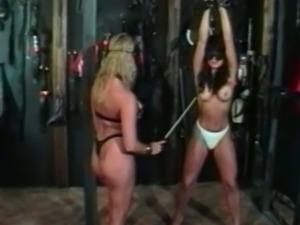 Sexy brunette slave gets punished by her mistress