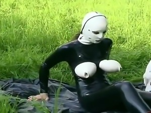 Big breasted domina in latex loves playing with sex toys outdoors
