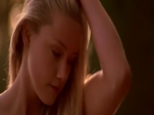 Amber Heard undressing at the edge of a river, ending up in her panties and...