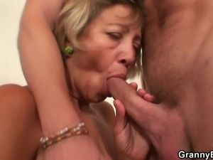 Mature blonde rides a young stud's hard cock