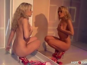 Blonde, sexy, flexible Jakelin Teen twirls around the stripper pole before...
