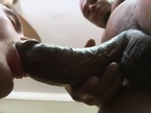 Skinny white stud sucks a big black cock