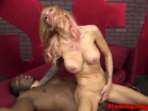 Tatttoed madame riding a BBC