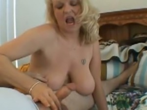 Old busty milf jerking that big cock on the camera