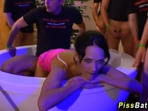 Fetish babe in group drinks piss as she fucks in bath in hd