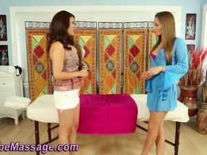 Gorgeous babe gets rubbed down by lesbian masseuse