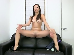 Long haired, slim Asian chick Lily naked, teasing her body and stimusexy her...