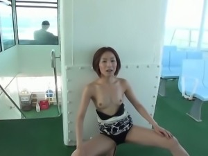 Japanese brunette strips and poses on the ferry