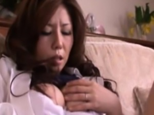 Busty mature asian milf fingers her clit