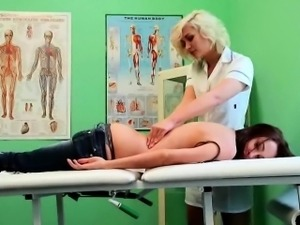 Brunette patient getting massaged by the nurse