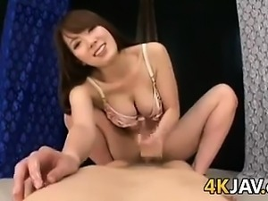 Japanese Beauty Playing With A Cock