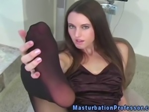 Pantyhose babe showing off her pussy through her sexy nylons