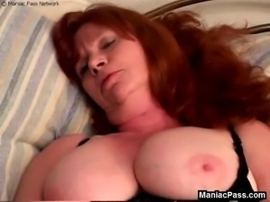 Redheaded mature giving an old-fashioned blowjob to a lucky black guy