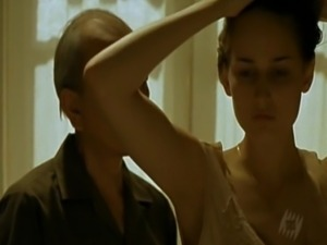 Pretty actress Leelee Sobieski naked while brushing her long hair