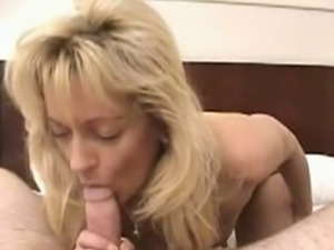 Horny mom sucks and spits on cock