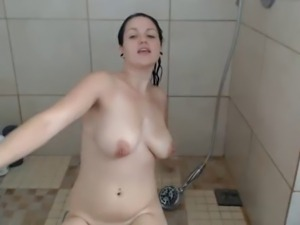 Girl uses shower head to play with her pussy