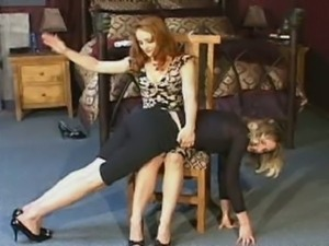 Mistress gemini spanks slave with a paddle