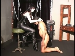 mistress in leather punishing slave
