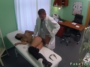 Hot brunette female patient with headache and back pain massaged gently by...