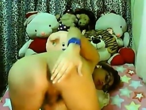 Asian tranny wearing glasses naked on cam and masturbating