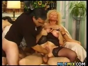 Horny mature woman having some fun with two horny guys