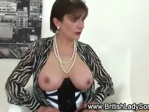 Busty mature Lady Sonia poses for pics in stockings