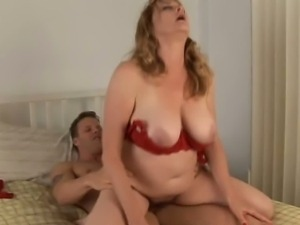 Blonde mature with mega jugs rides a big cock
