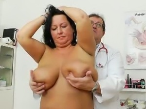 Doctor examines huge boobs and a mature cunt