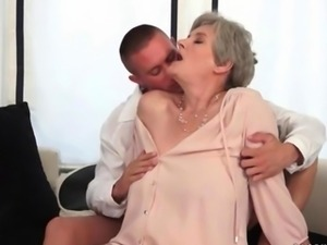 Busty grandma enjoys hot sex with her young bofriend