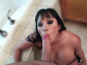 Gaia is an Oriental chick that gets fucked in her mouth while her hands are...