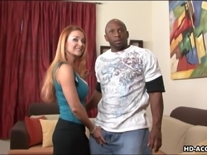 luscious redhead seduces an ebony guy