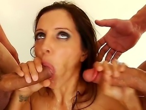 Sexy slut loves to get cum in her mouth. She is getting it from two men in...