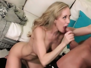 Brandi Love has fire in her eyes as she gets her lovely face painted with...